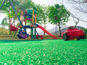 playground over artificial grass